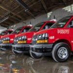 City Fire vans lined up in garage