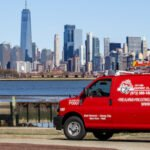 City Fire van in foreground with New York City in background
