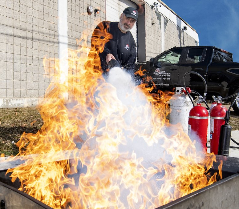 Outdoor fire extinguisher training with large fire