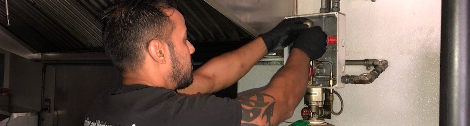 Close up of man inspecting a food truck