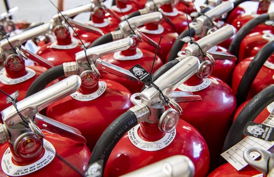Fire extinguishers lined up in rows