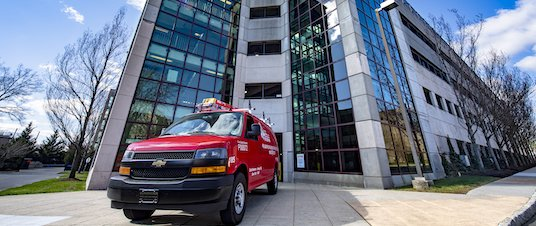City Fire van in front of parking structure