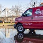 City Fire van with bridge in background