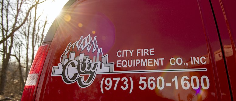 Close-up of back of City Fire van at sunset