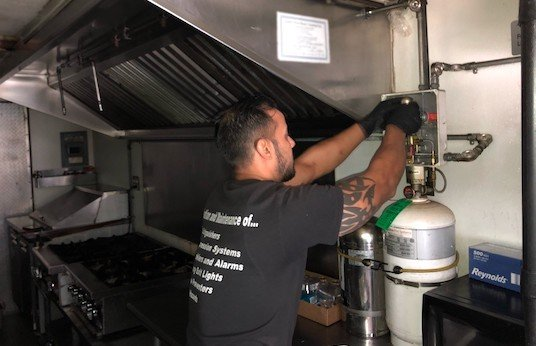 Man inspecting commercial kitchen