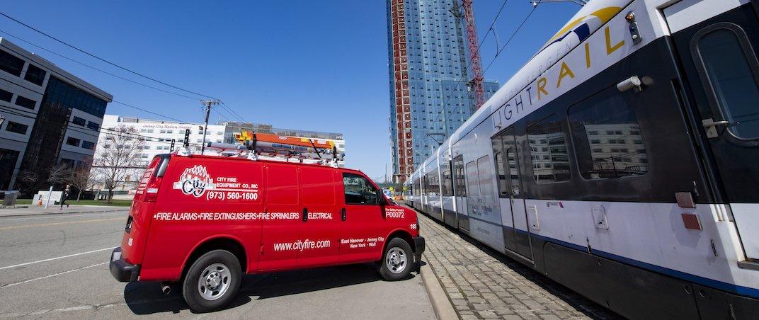 City Fire van next to train