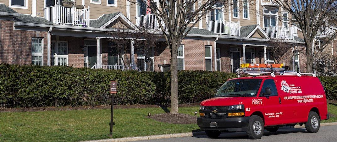 City Fire van in front of condo